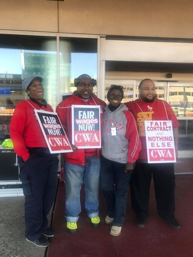 AREA REPRESENTATIVE DOUGLAS CHRISTIAN AND CLT MEMBERS PROTESTING OUTSIDE OF TERMINAL